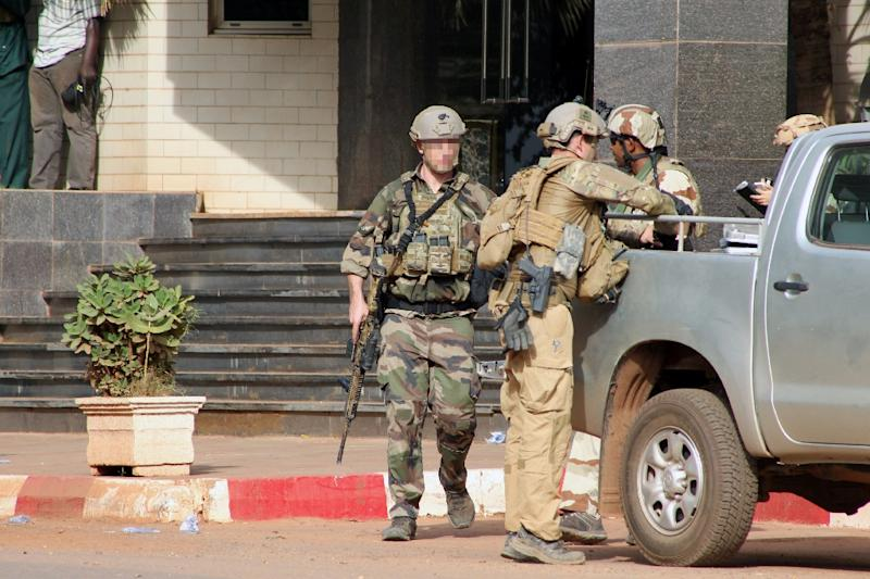 French special forces stand guard outside the Radisson Blu hotel in Bamako on November 20, 2015, after it was beseiged by jihadists