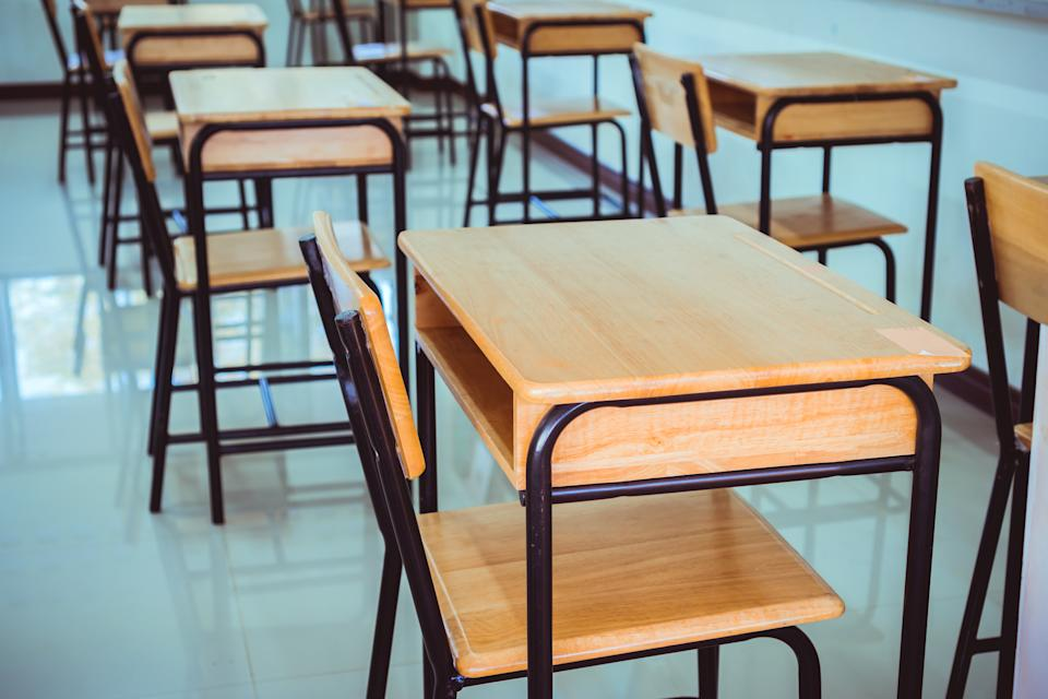 Back to school concept. School empty classroom, Lecture room with desks and chairs iron wood for studying lessons in highschool thailand without young student, interior of secondary education