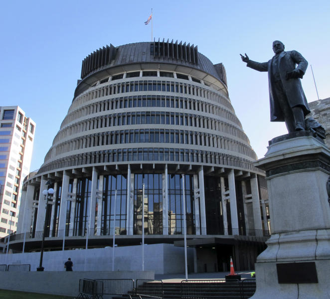 """In this Oct. 22, 2012 photo, the unusual design of the New Zealand Parliament's executive wing, known as the Beehive, graces the skyline in Wellington, New Zealand. Whether you're a fan making a pilgrimage to the city where the """"The Lord of the Rings"""" films were made, or you have no interest whatsoever in dwarfs and goblins, there's plenty to do in Wellington. For free. (AP Photo/Nick Perry)"""