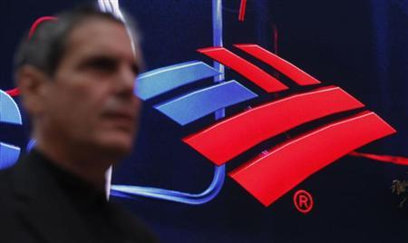A man walks next to a Bank of America's branch in New York