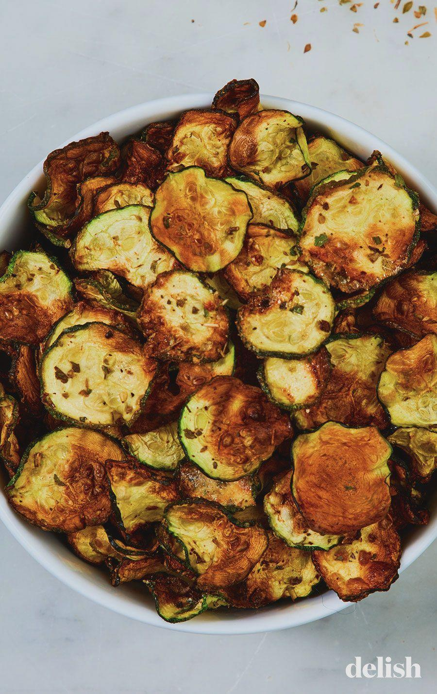 """<p>Like Doritos, but without all the post-snacking guilt. </p><p>Get the recipe from <a href=""""https://www.delish.com/cooking/recipe-ideas/a22344312/cool-ranch-zucchini-chips/"""" rel=""""nofollow noopener"""" target=""""_blank"""" data-ylk=""""slk:Delish"""" class=""""link rapid-noclick-resp"""">Delish</a>.</p>"""