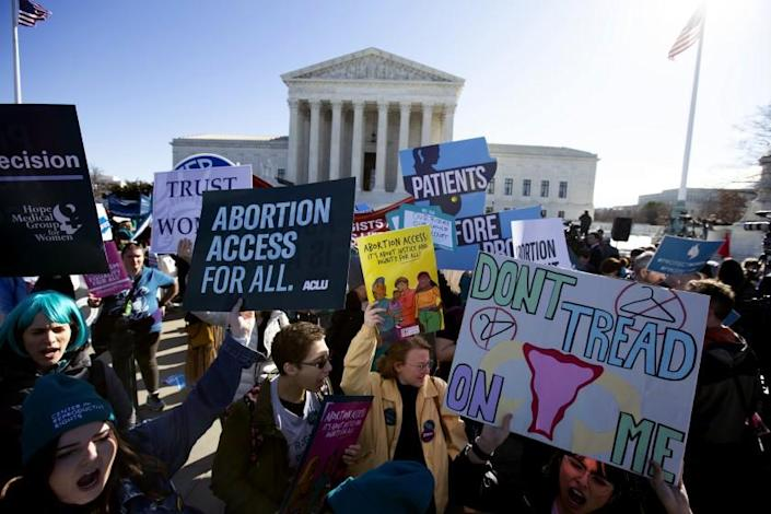 Abortion rights demonstrators along with Anti-abortion demonstrators rally outside of the U.S. Supreme Court in Washington, Wednesday, March 4, 2020. The Supreme Court is taking up the first major abortion case of the Trump era Wednesday, an election-year look at a Louisiana dispute that could reveal how willing the more conservative court is to roll back abortion rights. (AP Photo/Jose Luis Magana)