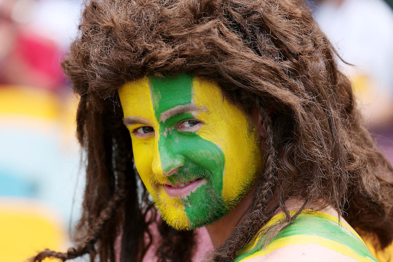 BRISBANE, AUSTRALIA - NOVEMBER 09:  Australian supporter cheers during day one of the First Test match between Australia and South Africa at The Gabba on November 9, 2012 in Brisbane, Australia.  (Photo by Chris Hyde/Getty Images)