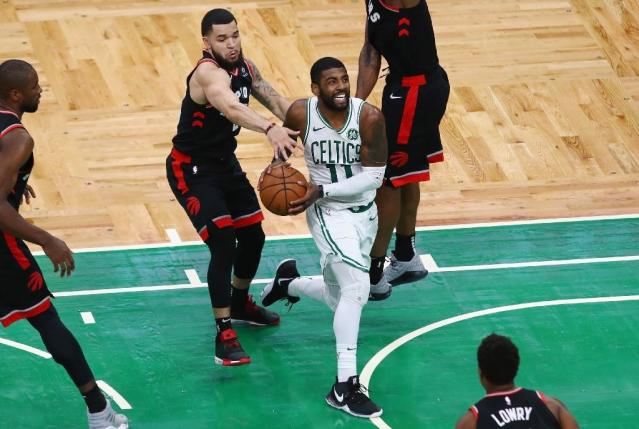 Boston's Kyrie Irving drives to the basket in overtime of the Celtics' 123-116 NBA victory over the Toronto Raptors (AFP Photo/Tim Bradbury)