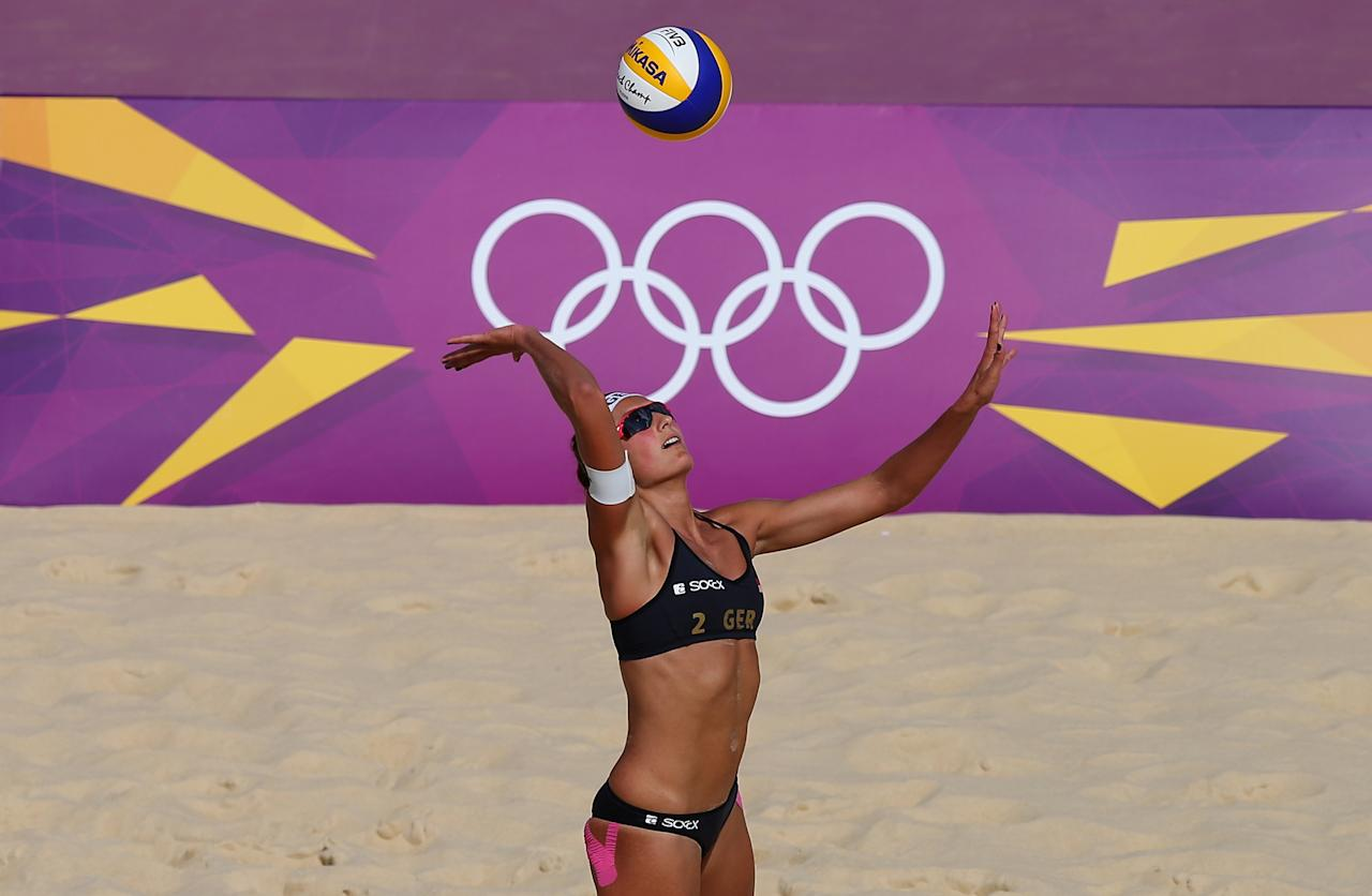 LONDON, ENGLAND - JULY 30:  Ilka Semmler of Germany serves during the Women's Beach Volleyball Preliminary match between Germany and Brazil on Day 3 of the London 2012 Olympic Games at Horse Guards Parade on July 30, 2012 in London, England.  (Photo by Ryan Pierse/Getty Images)