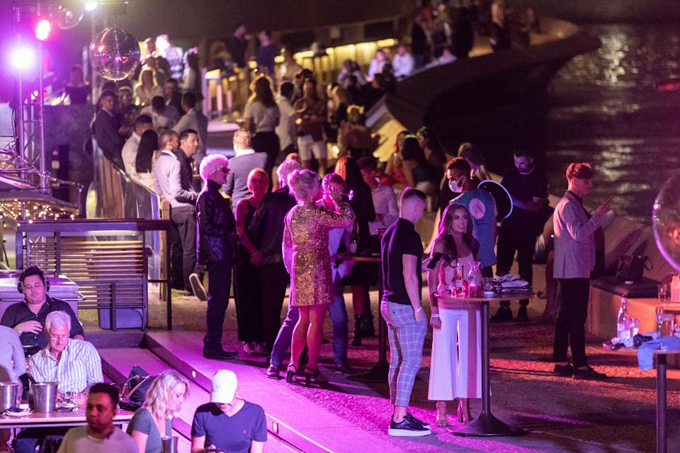 Patrons are seen at the Opera Bar during New Year's Eve celebrations on December 31, 2020 in Sydney.