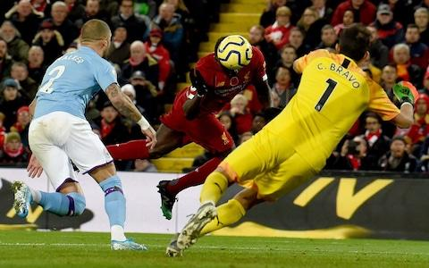 <span>Mane heads the ball beyond Claudio Bravo to hand Liverpool a three-goal lead</span> <span>Credit: Getty Images </span>