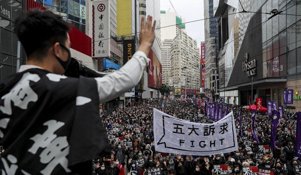 Protesters flash the ubiquitous 'five demands' gesture during an annual pro-democracy march in Causeway Bay in January. Photo: Sam Tsang