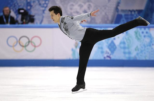 Patrick Chan of Canada competes in the men's free skate figure skating final at the Iceberg Skating Palace during the 2014 Winter Olympics, Friday, Feb. 14, 2014, in Sochi, Russia. (AP Photo/Bernat Armangue)