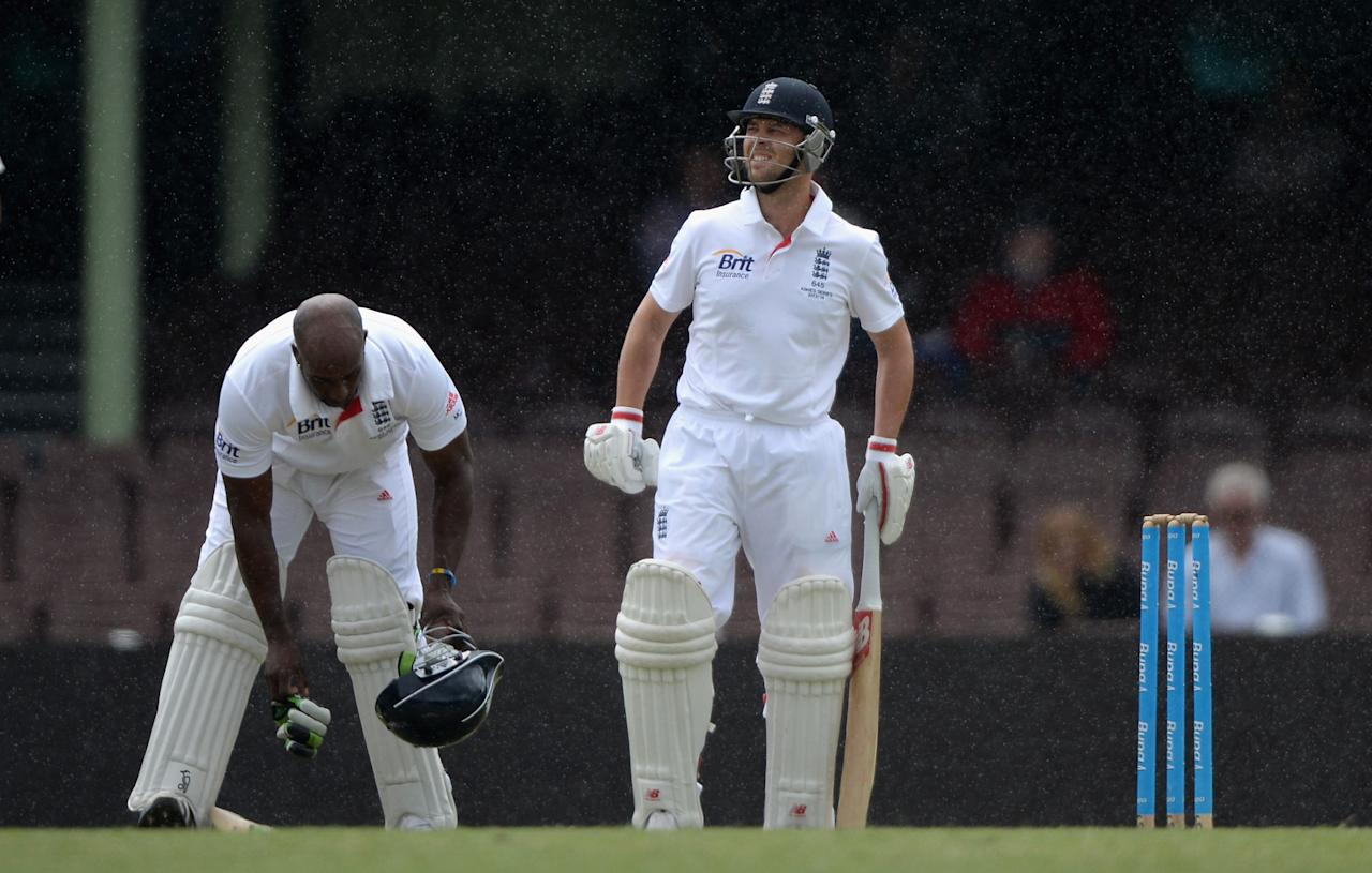 SYDNEY, AUSTRALIA - NOVEMBER 16:  Michael Carberry and Jonathan Trott of England as rain stops play during day four of the tour match between CA Invitational XI and England at the Sydney Cricket Ground on November 16, 2013 in Sydney, Australia.  (Photo by Gareth Copley/Getty Images)