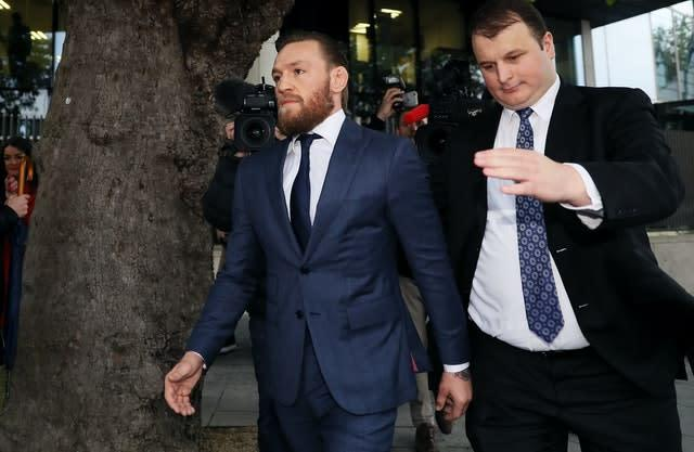 McGregor leaving Dublin District Court (Brian Lawless/PA)