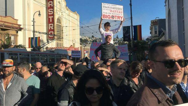 PHOTO: Protesters listen to speakers at a demonstration against a proposed ban of transgendered people in the military in the Castro District, Wednesday, July 26, 2017, in San Francisco. (AP)