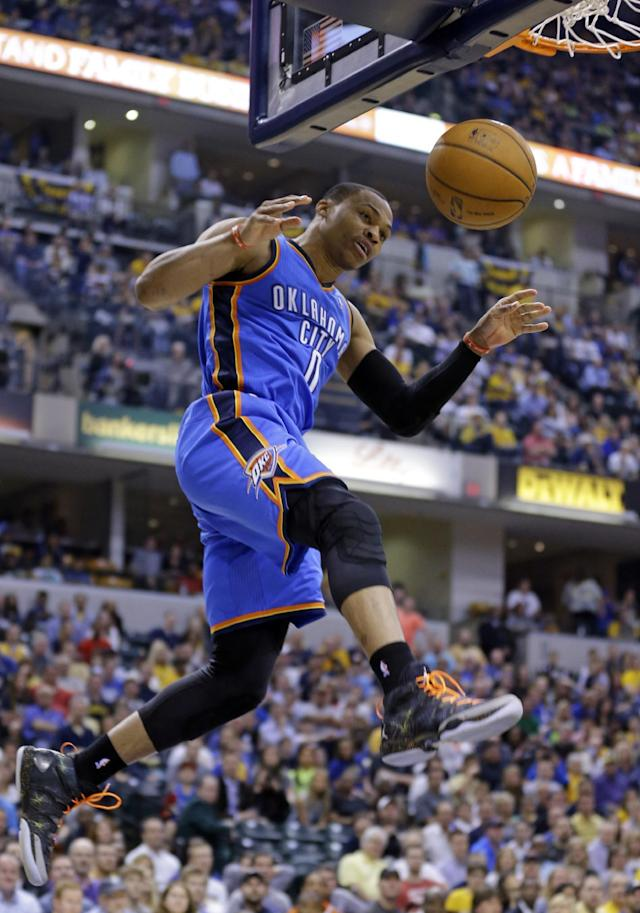Oklahoma City Thunder guard Russell Westbrook comes down after a dunk against the Indiana Pacers in the second half of an NBA basketball game in Indianapolis, Sunday, April 13, 2014. (AP Photo/Michael Conroy)