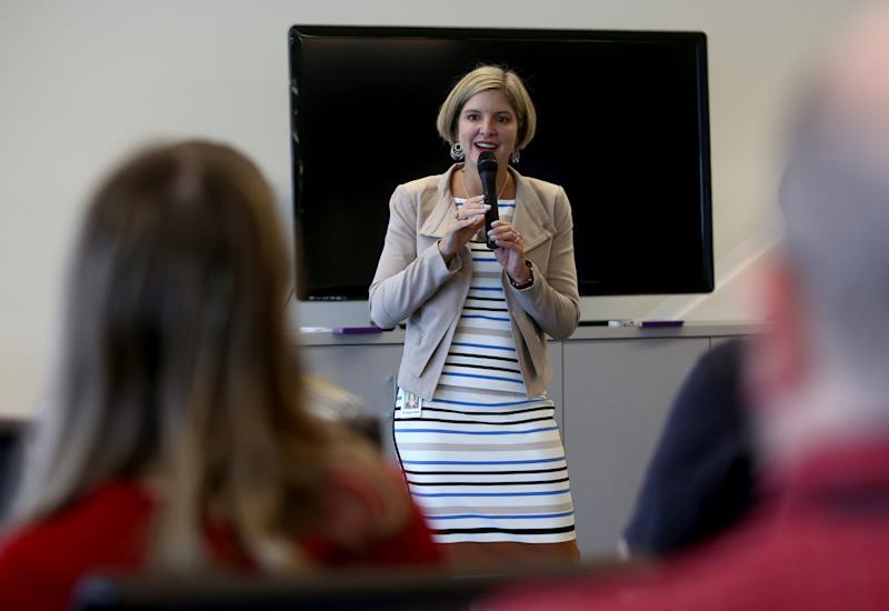 GreenPath Financial Wellness is working on two-year project, which begins in 2020, to offer virtual financial coaching to help low-to-moderate income consumers. File photo: GreenPath Financial Wellness CEO Kristen Holt talks with employees on April 20, 2016. Eric Seals/Detroit Free Press