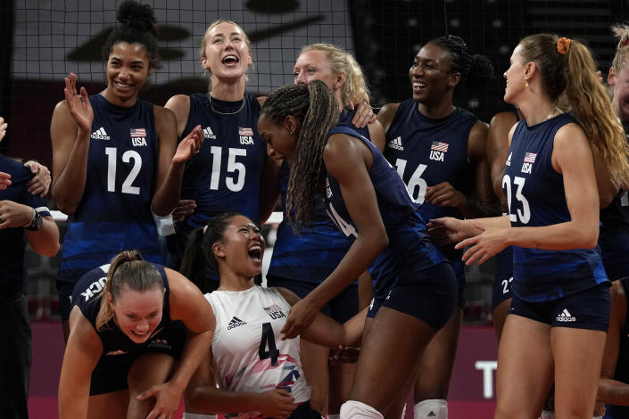 United States players celebrate winning the women's volleyball quarterfinal match between Dominican Republic and United States at the 2020 Summer Olympics, Wednesday, Aug. 4, 2021, in Tokyo, Japan. (AP Photo/Frank Augstein)