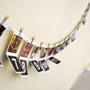 """<p>Celebrate the run up to Christmas with this unique, personalised take on the advent calendar. Each numbered day is hung using miniature wooden pegs from a length of decorative string; open to reveal a different image of your choice in a Polaroid style. <br></p><p>£14 <a href=""""http://www.notonthehighstreet.com/instajunction/product/personalised-photo-christmas-advent-calendar?utm_source=linkshare&utm_medium=affiliate&utm_campaign=UKNetwork&utm_content=1&utm_term=TnL5HPStwNw&ranMID=36027&ranEAID=TnL5HPStwNw&ranSiteID=TnL5HPStwNw-1GC5yUvLBr9TpOykruygeA"""" rel=""""nofollow noopener"""" target=""""_blank"""" data-ylk=""""slk:Not On The High Street"""" class=""""link rapid-noclick-resp"""">Not On The High Street</a></p>"""