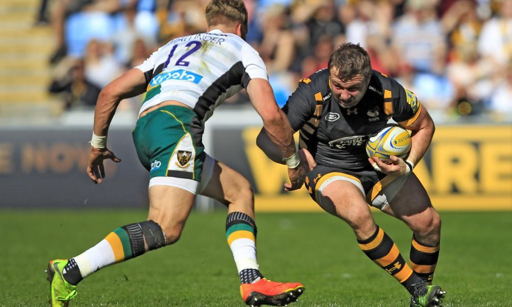 Matt Mullan , right, seen here taking on Harry Mallinder in April's 32-30 win over Northampton Saints, says Wasps are all proud of their long undefeated home record.