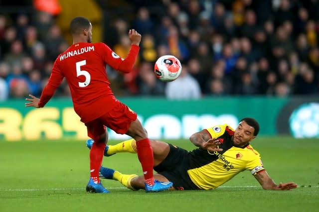 Liverpool's unbeaten Premier League run came to a shuddering halt at 44 games following a shock loss at lowly Watford. Troy Deeney, right, added to a brace from Ismaila Sarr to complete a resounding 3-0 scoreline as the Reds were stunned at Vicarage Road (Adam Davy/PA)