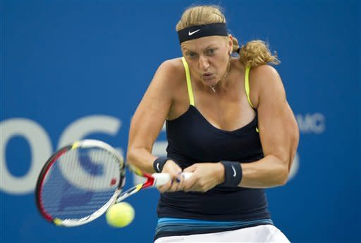 Petra Kvitova, from the Czech Republic, returns to Li Na, from China, during the final match at the Rogers Cup women's tennis tournament, Monday, Aug. 13, 2012, in Montreal. (AP Photo/The Canadian Press, Paul Chiasson)