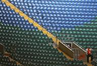 EMPTY SEATS PLAGUE ORGANIZERS: London Olympic organizers were under intense pressure to fill stadiums and venues after empty seats clearly visible on television infuriated British viewers who would much rather have experienced the Games live. Empty seats are seen at the women's first round Group F preliminary soccer match between Japan and South Africa at the London 2012 Olympic Games at the Millennium Stadium in Cardiff, July 31, 2012.