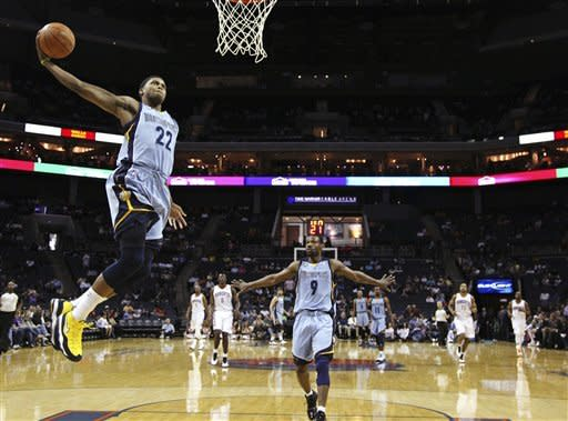 Memphis Grizzlies' Rudy Gay (22) dunks against the Charlotte Bobcats as Grizzlies' Tony Allen (9) watches during the first half of an NBA basketball game in Charlotte, N.C., Friday, April 20, 2012. (AP Photo/Chuck Burton)