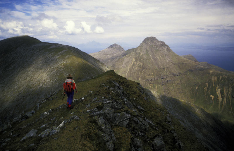 Mountain walking on Isle of Rhum, Scotland. (Photo by: Photofusion/Universal Images Group via Getty Images)