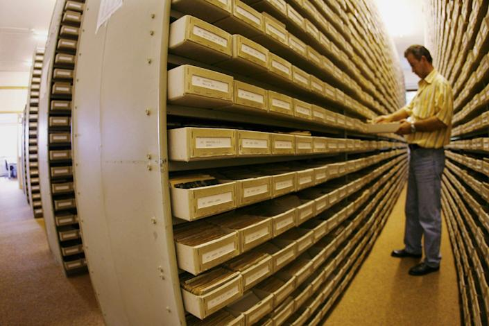 An employee of the International Tracing Service (ITS), an arm of the International Committee of the Red Cross based in Bad Arolsen, works in a part of the ITS files department on July 28, 2006. (MARTIN OESER/AFP/GettyImages)