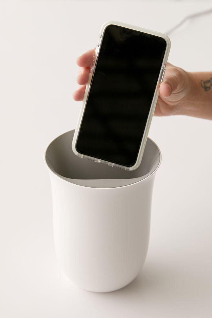 "This UV light sanitizer bin charges phones and disinfects phones in 20 minutes. <a href=""https://fave.co/313ZbM2"" target=""_blank"" rel=""noopener noreferrer"">Find it for $80 at Urban Outfitters</a>."