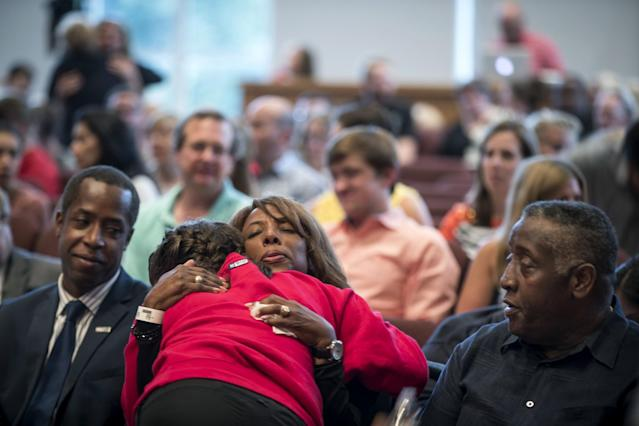 <p>School president Donna Harris hugs ninth-grader Alexis Stanley as she arrives at a prayer service at the Minnehaha Academy Lower School on Aug. 2, 2017, in Minneapolis, Minn. Firefighters were searching for a man believed to be buried in the rubble of the collapsed school building in Minneapolis on Wednesday after an explosion killed another school employee and injured several others. (Renee Jones Schneider /Star Tribune via AP) </p>