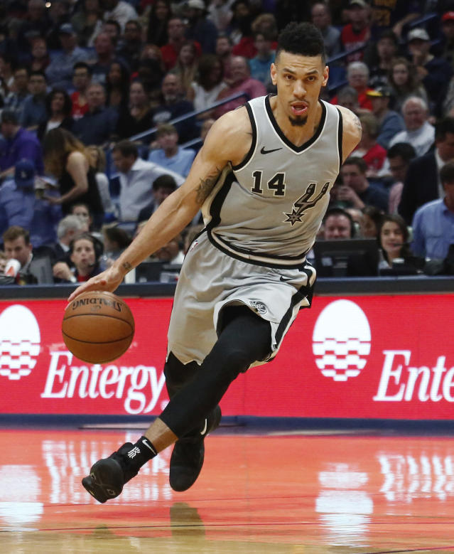 FILE - In this April 11, 2018, file photo, San Antonio Spurs guard Danny Green (14) drives against the New Orleans Pelicans in the second half of an NBA basketball game in New Orleans. Two people familiar with the situation say San Antonio and Toronto have reached an agreement in principle on a trade that will send Kawhi Leonard to the Raptors and DeMar DeRozan to the Spurs. One of the people says the Spurs also are sending Danny Green to the Raptors as part of the deal. Both people spoke to The Associated Press on condition of anonymity Wednesday, July 18, 2018, because the deal has not been finalized. (AP Photo/Scott Threlkeld, File)