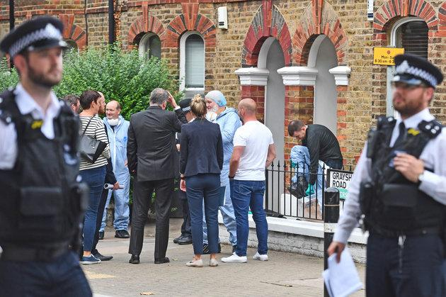 Detectives outside a property on Grayshott Road in Battersea, south-west London