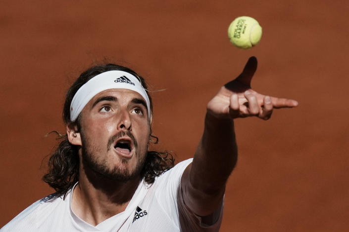 Stefanos Tsitsipas of Greece serves the ball to Serbia's Novak Djokovic during their final match of the French Open tennis tournament at the Roland Garros stadium Sunday, June 13, 2021 in Paris. (AP Photo/Thibault Camus)