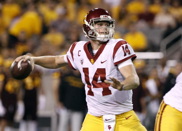 FILE – In this Saturday, Oct. 28, 2017 file photo, Southern California quarterback Sam Darnold throws a pass during the first half of an NCAA college football game against Arizona State in Tempe, Ariz. Southern California quarterback Sam Darnold will skip his final two seasons of eligibility to enter the NFL draft. (AP Photo/Ralph Freso, File)
