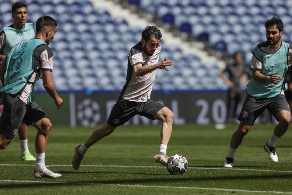 Manchester City's Bernardo Silva, center, plays the ball next to his teammates during a training session ahead of the Champions League final match at the Dragao stadium in Porto, Portugal, Friday, May 28, 2021. Manchester City and Chelsea will play the Champions League final on Saturday. (AP Photo/Manu Fernandez)