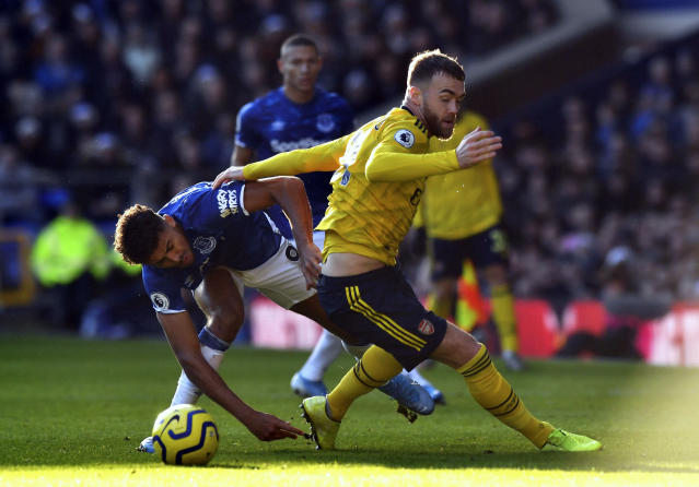 Everton's Dominic Calvert-Lewin, left, and Arsenal's Calum Chambers battle for the ball during the English Premier League soccer match between Everton and Arsenal at Goodison Park, Liverpool, England, Saturday, Dec. 21, 2019. (Anthony Devlin/PA via AP)