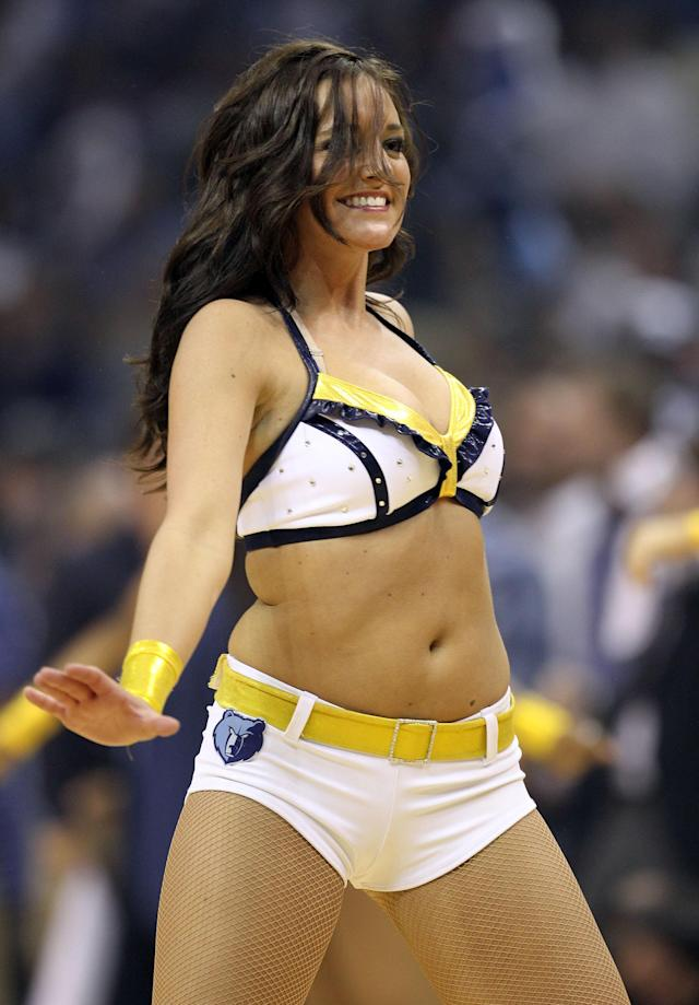 MEMPHIS, TN - APRIL 23: A Memphis Grizzlies cheerleader performs during the game against the San Antonio Spurs in Game three of the Western Conference Quarterfinals in the 2011 NBA Playoffs at FedExForum on April 23, 2011 in Memphis, Tennessee. NOTE TO USER: User expressly acknowledges and agrees that, by downloading and/or using this Photograph, User is consenting to the terms and conditions of the Getty Images License Agreement. (Photo by Andy Lyons/Getty Images)