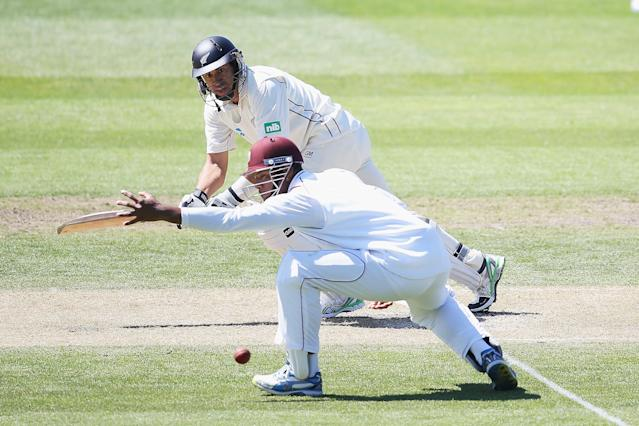 DUNEDIN, NEW ZEALAND - DECEMBER 04: Ross Taylor of New Zealand flicks the ball away during day two of the first test match between New Zealand and the West Indies at University Oval on December 4, 2013 in Dunedin, New Zealand. (Photo by Hannah Johnston/Getty Images)