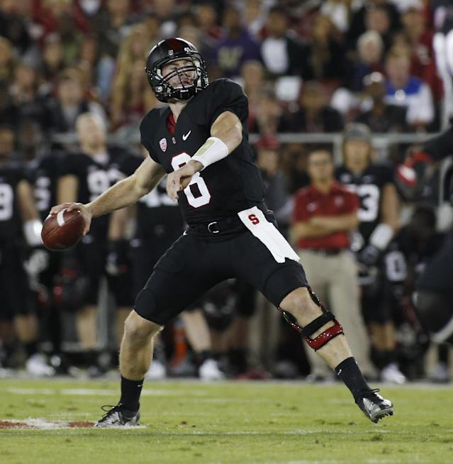 Stanford quarterback Kevin Hogan throws a pass against Washington during the first half of an NCAA college football game in Stanford, Calif., Saturday, Oct. 5, 2013. (AP Photo/George Nikitin)