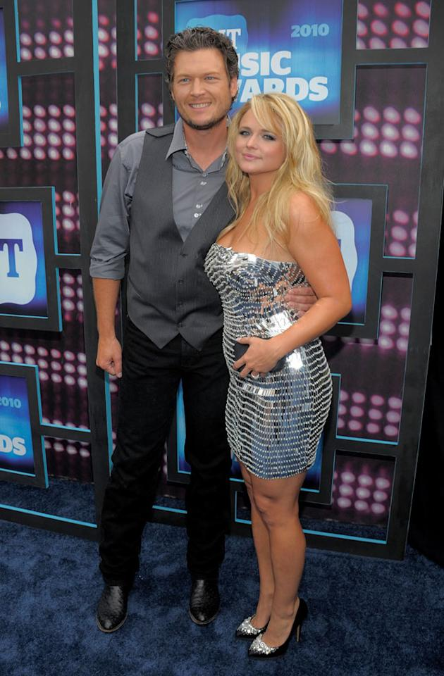 """Blake Shelton opted for a painfully casual ensemble, while his fiancee Miranda Lambert accentuated her voluptuous frame in a mirrored frock and bedazzled pumps. Kevin Mazur/<a href=""""http://www.wireimage.com"""" target=""""new"""">WireImage.com</a> - June 9, 2010"""