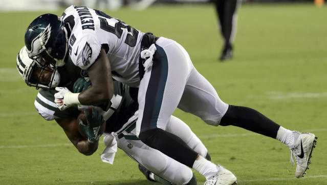 Philadelphia Eagles' LaRoy Reynolds (50) tackles New York Jets' Charone Peake during the second half of a preseason NFL football game Thursday, Aug. 30, 2018, in Philadelphia. (AP Photo/Michael Perez)