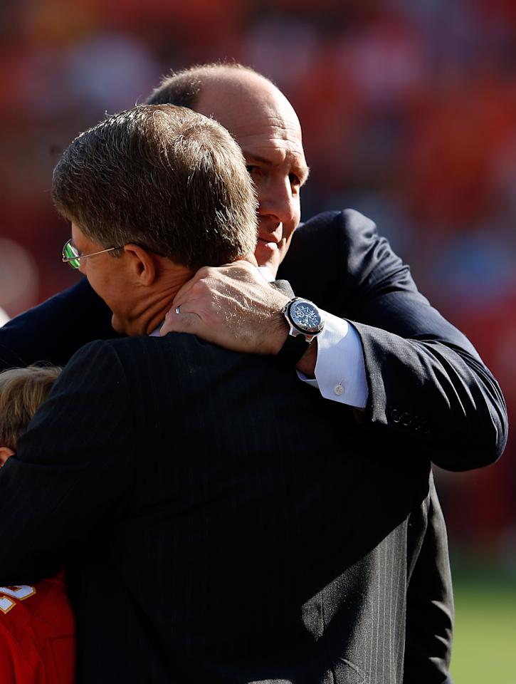 KANSAS CITY, MO - DECEMBER 02:  General Manager Scott Pioli of the Kansas City Chiefs hugs owner Clark Hunt prior to the game against the Carolina Panthers at Arrowhead Stadium on December 2, 2012 in Kansas City, Missouri.  (Photo by Jamie Squire/Getty Images)