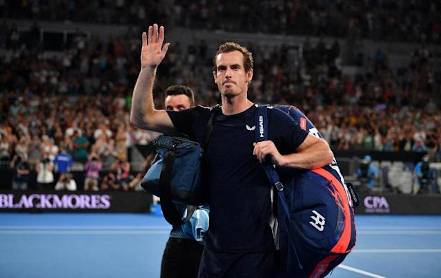 Britain's Andy Murray waves to supporters after his defeat against Spain's Roberto Bautista Agut in the first round of the Australian Open -- potentially his final match as a professional (AFP Photo/SAEED KHAN)