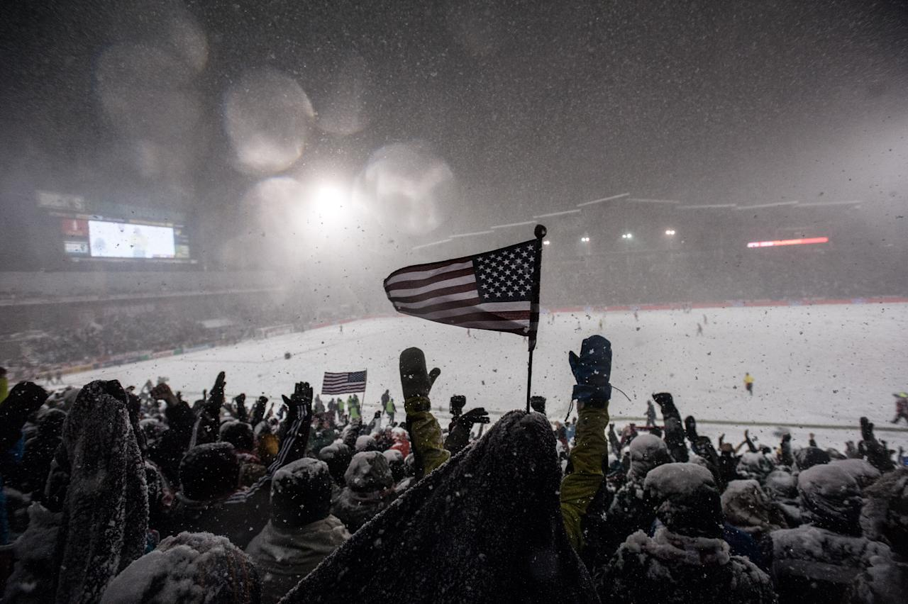 COMMERCE CITY, CO - MARCH 22:  Fans of the United States national soccer team cheer as time runs out on a snowy night during a FIFA 2014 World Cup Qualifier match between Costa Rica and United States at Dick's Sporting Goods Park on March 22, 2013 in Commerce City, Colorado. (Photo by Dustin Bradford/Getty Images)