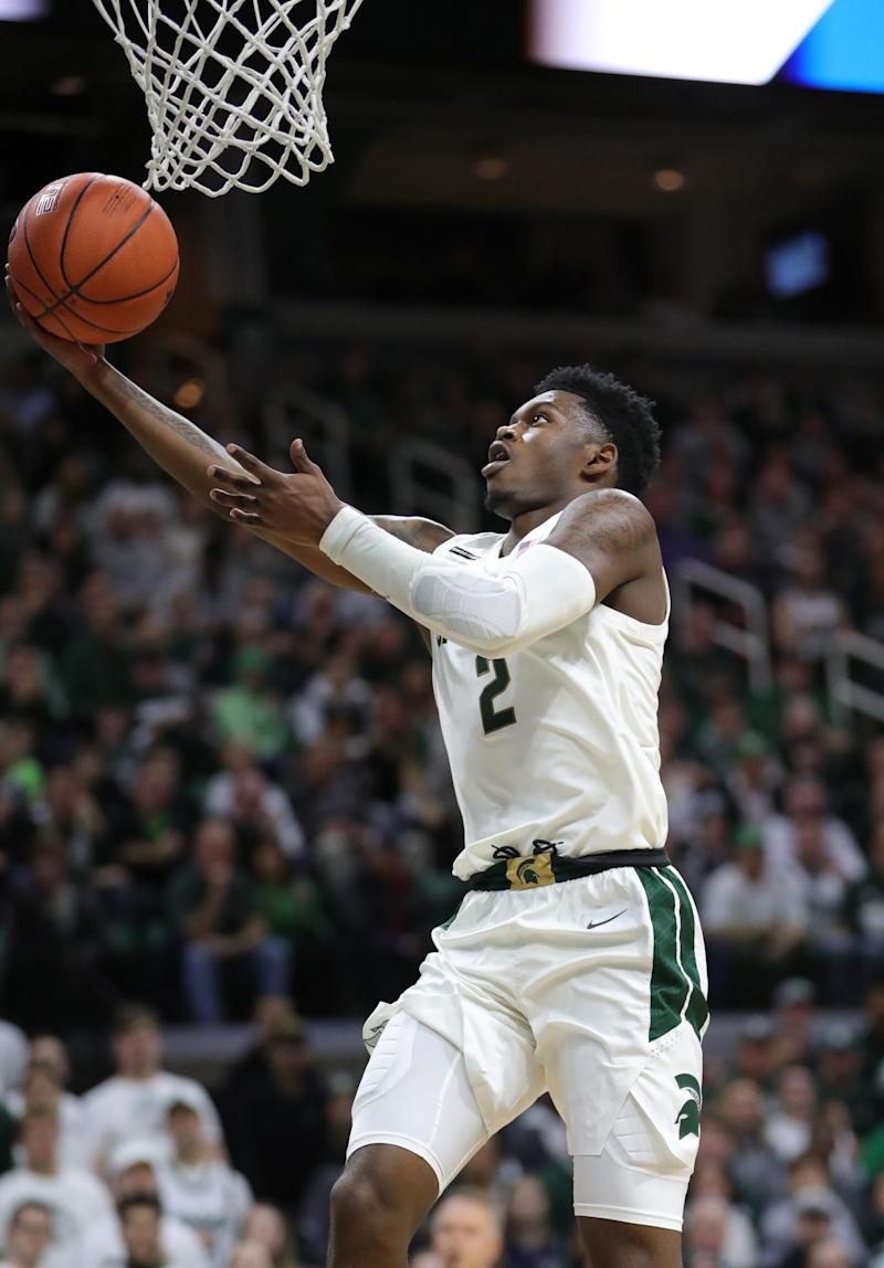 Michigan State Spartans guard Rocket Watts (2) scores against the Iowa Hawkeyes during first half action Tuesday, February 25, 2020 at the Breslin Center in East Lansing, Mich.