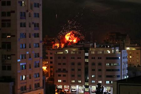 A ball of fire is seen during an Israeli air strike in Gaza City May 4, 2019. REUTERS/Suhaib Salem