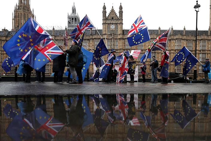 Image: Anti-Brexit demonstrators wave U.K. and E.U. flags opposite the Houses of Parliament in London in December 2018. (Daniel Leal-Olivas / AFP - Getty Images file)