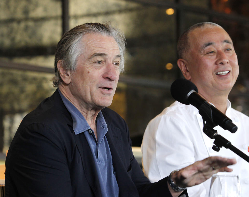 Actor Robert De Niro, left, speaks as chef Nobu Matsuhisa listens during a press conference prior to the official opening of the Nobu Restaurant at the Burswood Entertainment Complex in Perth, Australia, Sunday, March 25, 2012. The Nobu Restaurant in Perth will be the 24th to open which are co-owned by De Niro and Matsuhisa. (AP Photo/Theron Kirkman)
