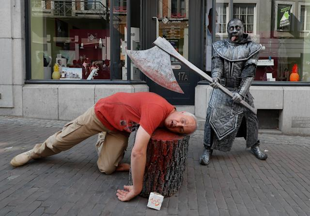 "<p>An artist called ""Le Bourreau/The Headsman"" takes part in the festival ""Statues en Marche"" in Marche-en-Famenne, Belgium, July 22, 2018. (Photo: Yves Herman/Reuters) </p>"