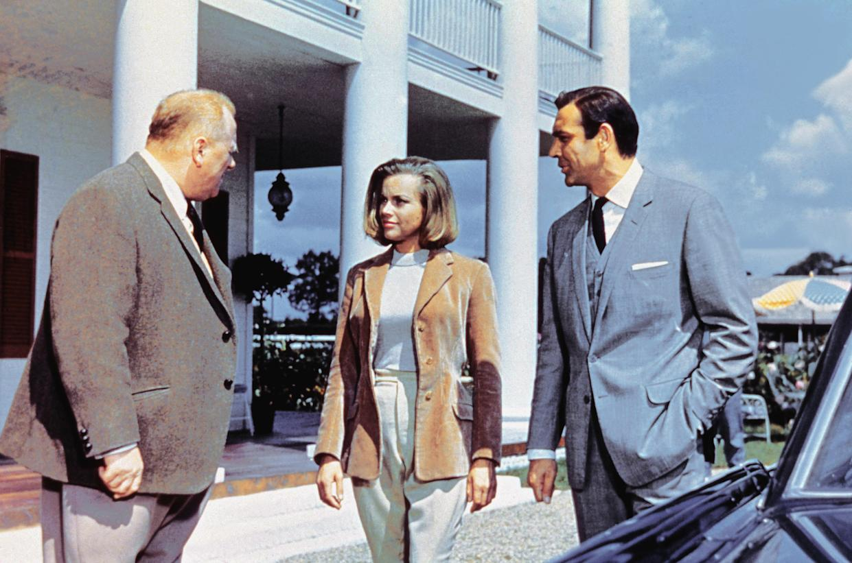 Actors Gert Frobe, Sean Connery and actress Honor Blackman on the set of