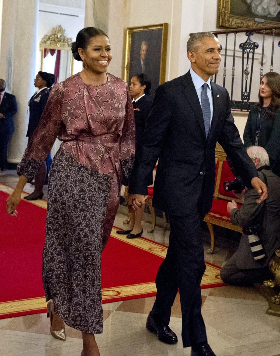 """<p>To help President Barack Obama present dignitaries including <a rel=""""nofollow"""" href=""""https://www.yahoo.com/tv/ellen-degeneres-tears-white-house-015400854.html"""" data-ylk=""""slk:Ellen DeGeneres;outcm:mb_qualified_link;_E:mb_qualified_link;ct:story;"""" class=""""link rapid-noclick-resp yahoo-link"""">Ellen DeGeneres</a>, Cicely Tyson, Michael Jordan, and more with the Presidential Medal of Freedom, first lady Michelle Obama wore a very fashionable Dries Van Noten dress. <a rel=""""nofollow"""" href=""""https://www.yahoo.com/style/first-lady-michelle-obama-s-1281549735419958/photo-michelle-obama-in-dries-van-1478619905500.html"""" data-ylk=""""slk:FLOTUS actually wore the silk patterned piece before;outcm:mb_qualified_link;_E:mb_qualified_link;ct:story;"""" class=""""link rapid-noclick-resp yahoo-link"""">FLOTUS actually wore the silk patterned piece before</a> when she was visiting Qatar on a Let Girls Learn trip last December. But this time around, she paired the silk number with festive gold heels and pulled her hair back into a fancy chignon. </p>"""